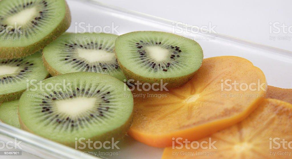 kiwi and persimmon royalty-free stock photo