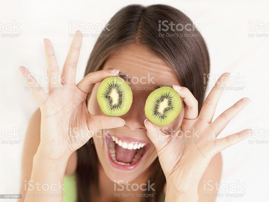 Kiwi fruit woman fun stock photo