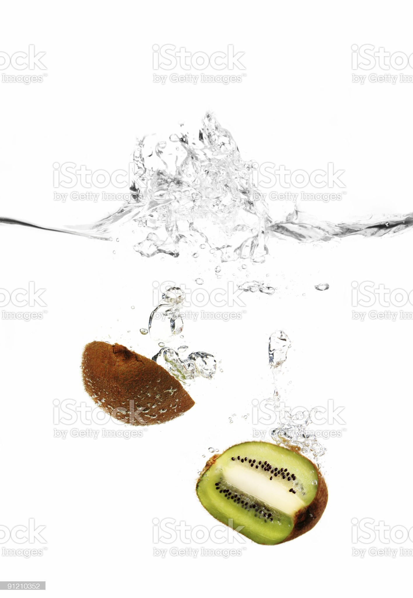 Kiwi in water royalty-free stock photo