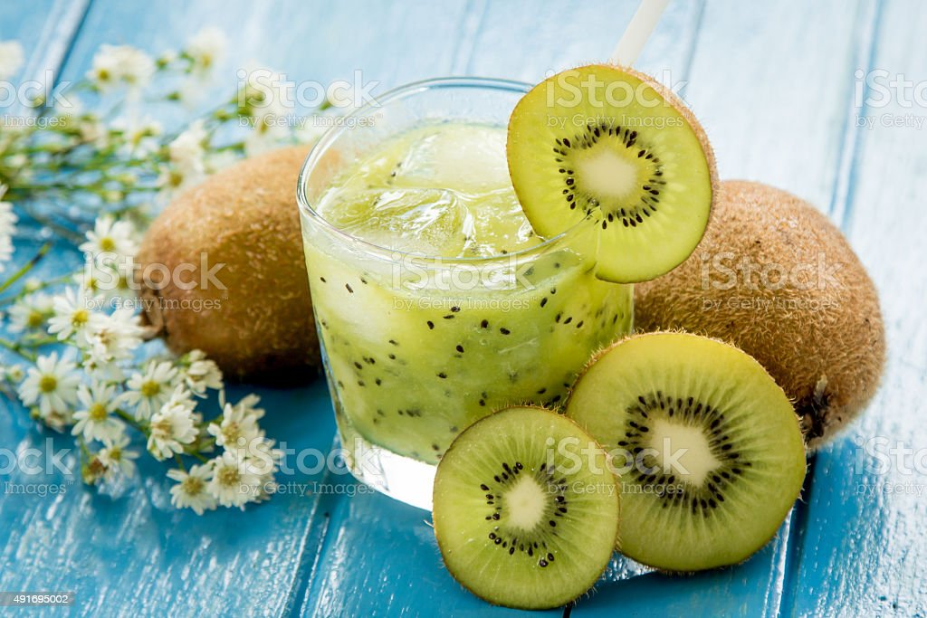 kiwi juice with fresh fruits on blue wooden table stock photo