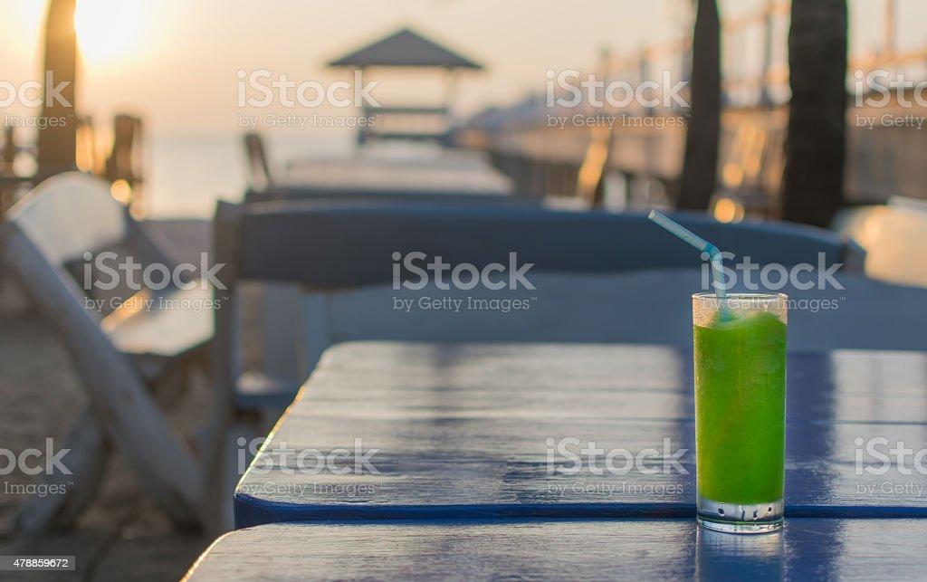 Kiwi smoothies on the wooden table stock photo