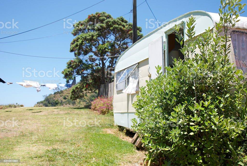 Kiwi Summer; Caravan by Sea and Washing stock photo