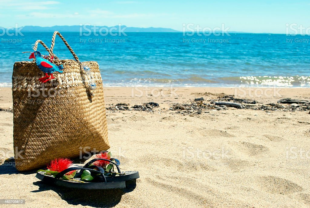 Kiwiana Christmas, Flax Kete and Jandals by the Sea stock photo