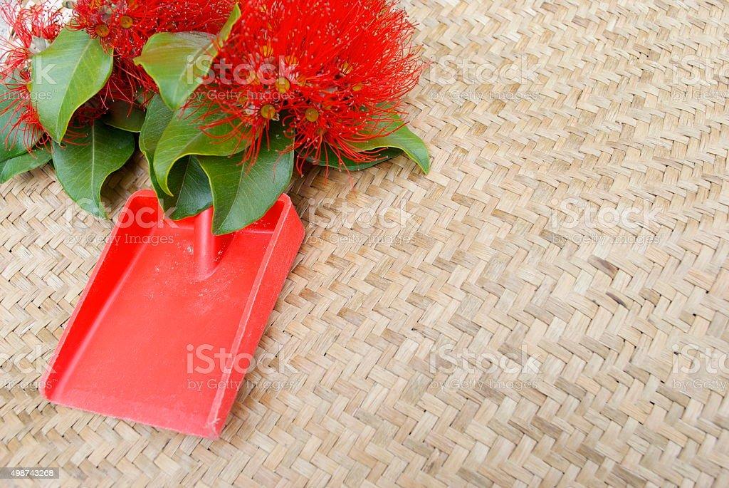 Kiwiana Christmas, Pohutakawa Flowers with Spade stock photo