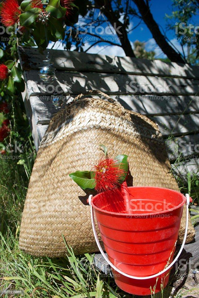 Kiwiana Summer, a Kete, Bucket & Pohutakawa Flower stock photo