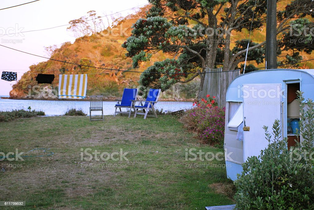 Kiwiana Summer; Caravan by Sea and Washing stock photo