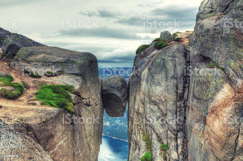 Kjerag Kjeragbolten rock in Kjerag Mountains, Norway stock photo