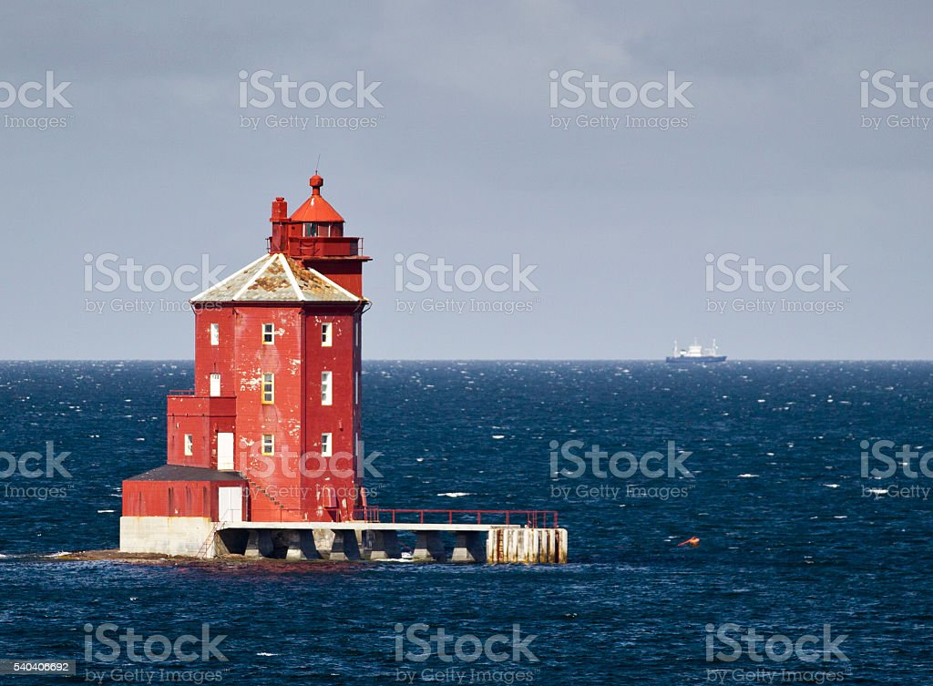 Kjeungskjaer red lighthouse and ship north of Trondheim Norway stock photo