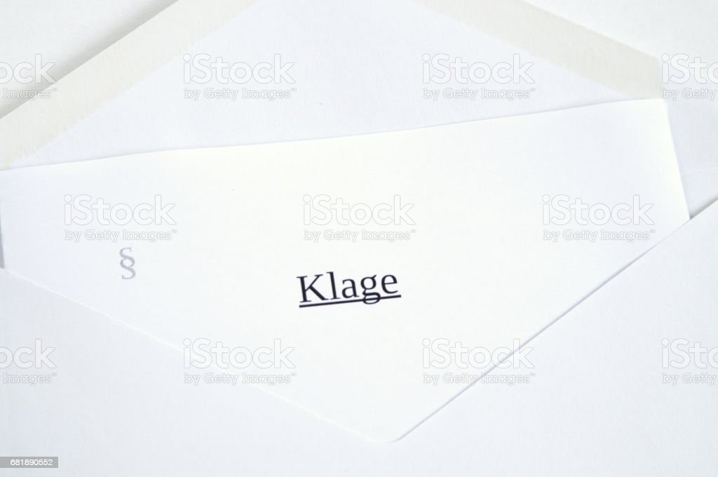 Klage (lawsuit) printed on white paper and envelope stock photo