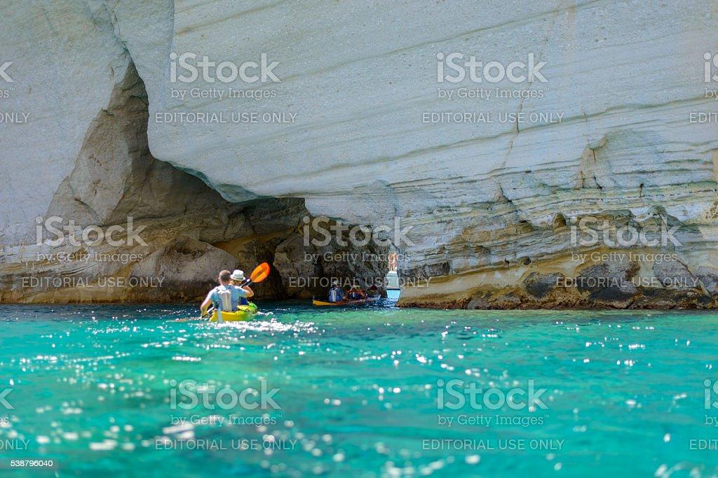 Kleftiko rock formations kayaking Melos, Greece stock photo