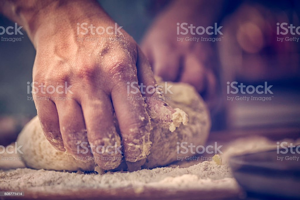 Kneading Dough with Hands On the Table stock photo