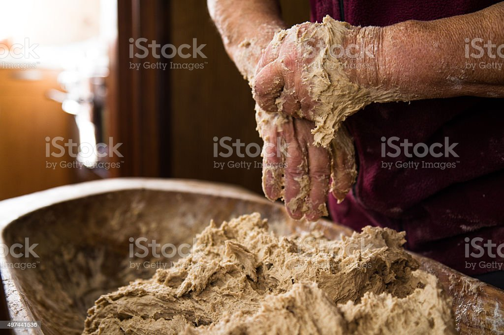 Kneading Yeast Dough In Traditional Way stock photo