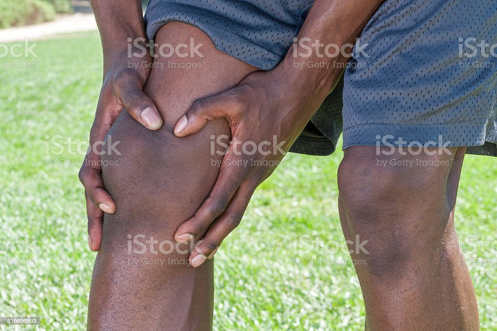 Knee injury closeup stock photo