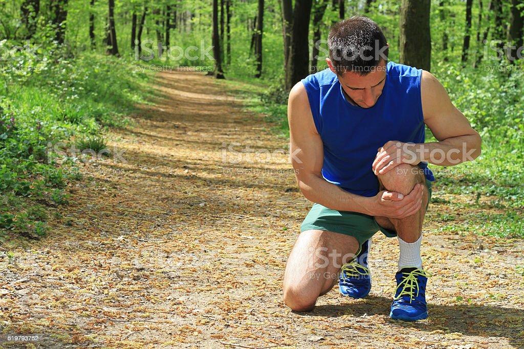 Knee injury, Man runner with knee pain stock photo
