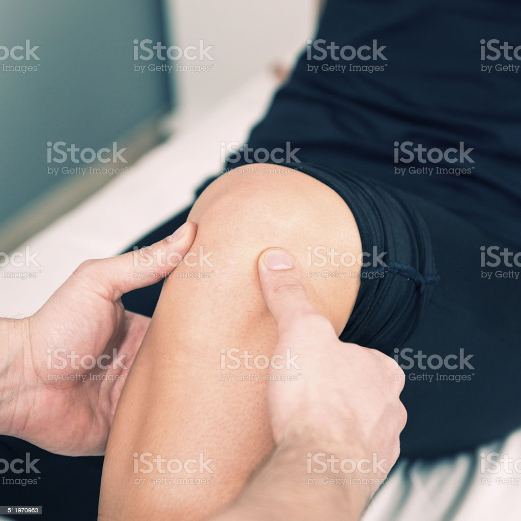Knee pain tratment stock photo
