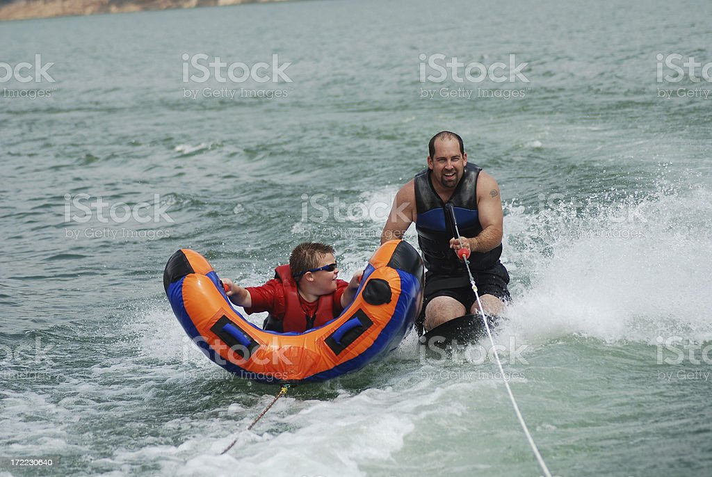 Kneeboarding and Tubing Together stock photo