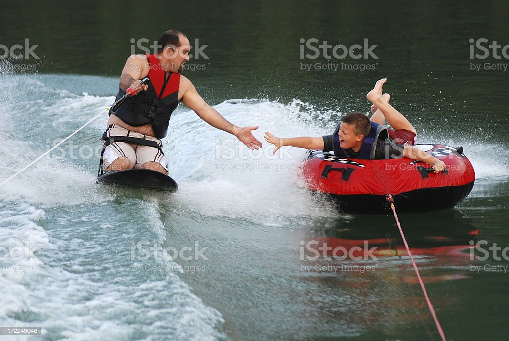 Kneeboarding and Tubing with Dad royalty-free stock photo