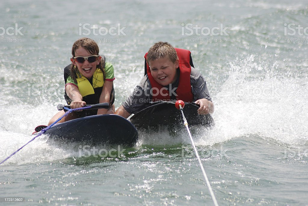 Kneeboarding Cousins royalty-free stock photo