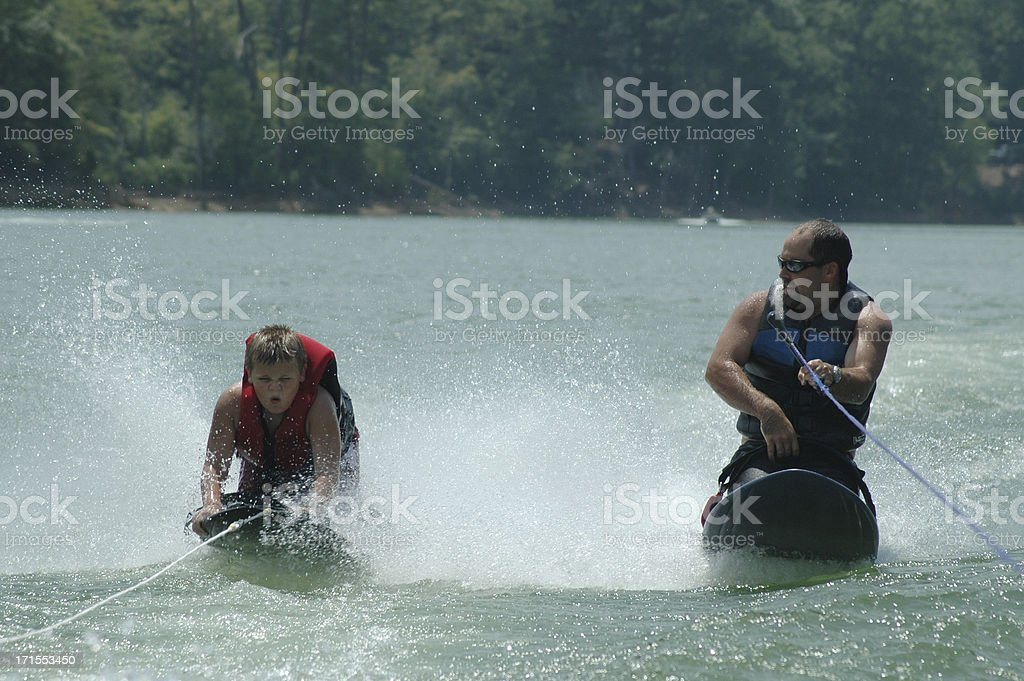 Kneeboarding with my Dad stock photo