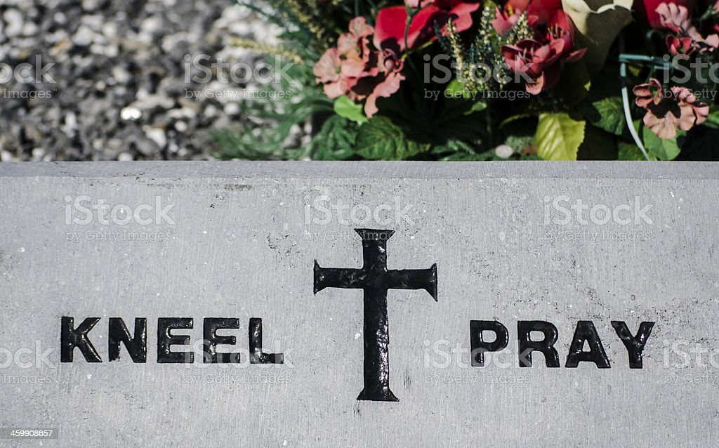 kneel and pray sign stock photo