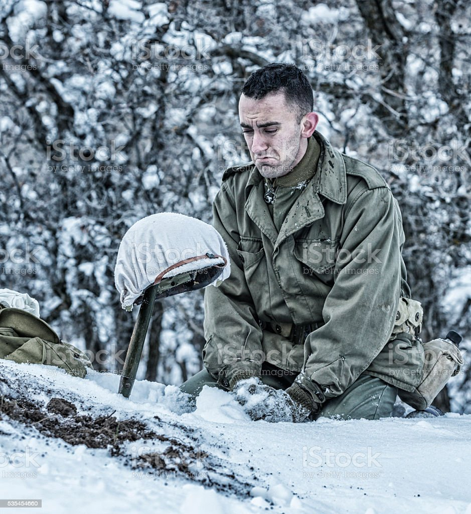 Kneeling Crying WWII US Army Soldier Mourning For Dead Buddy stock photo