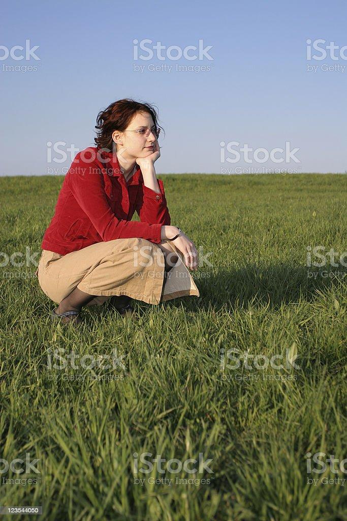 Kneeling girl royalty-free stock photo