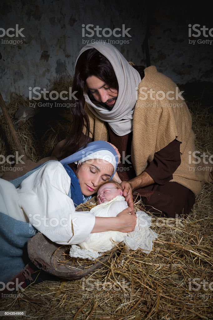 Kneeling parents in nativity scene stock photo