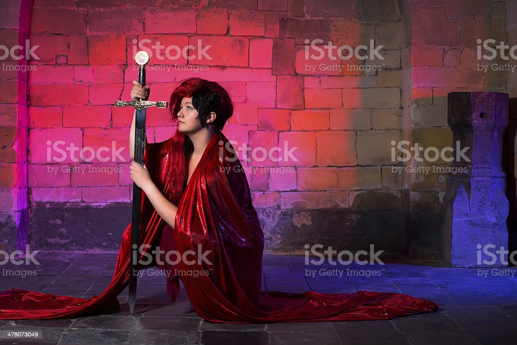 Kneeling with a sword royalty-free stock photo