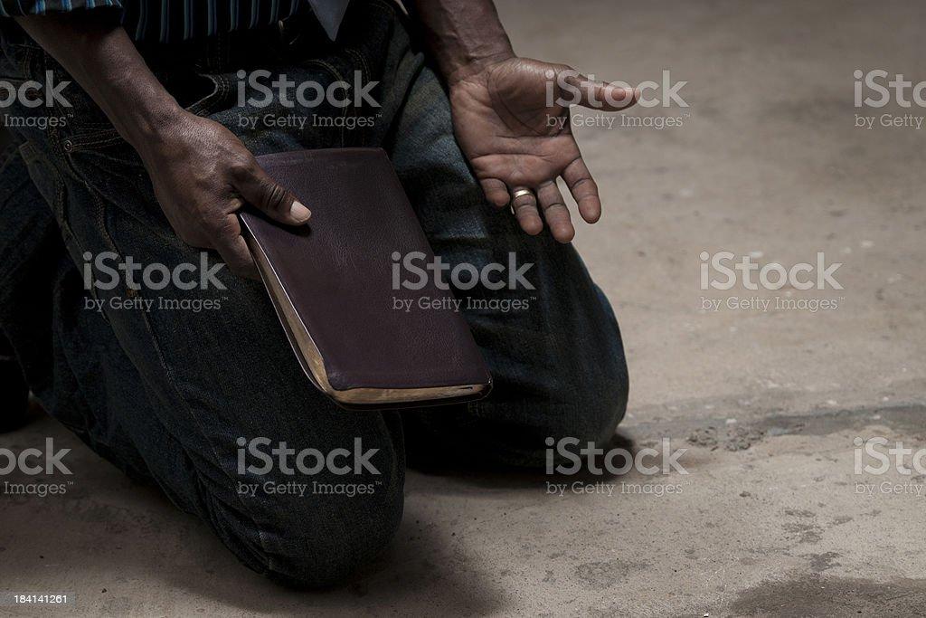 kneeling with bible stock photo