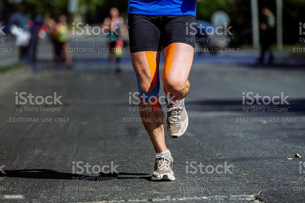 knees kinesio taping male athlete royalty-free 스톡 사진