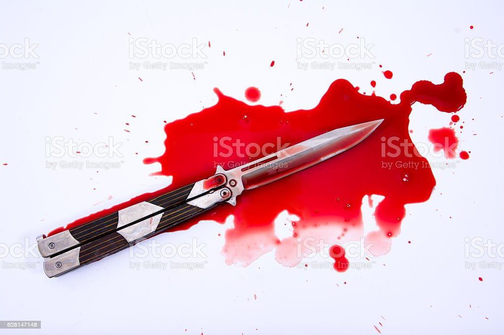 Knife and blood splatter on white background.Kill concept. stock photo