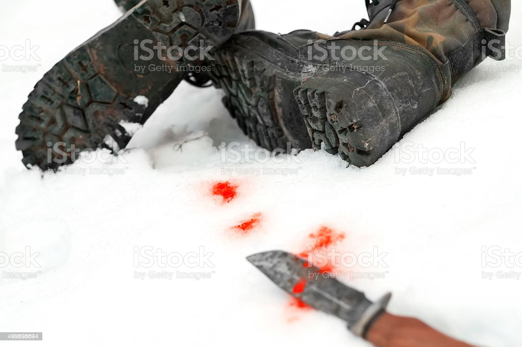 Knife And Boots stock photo