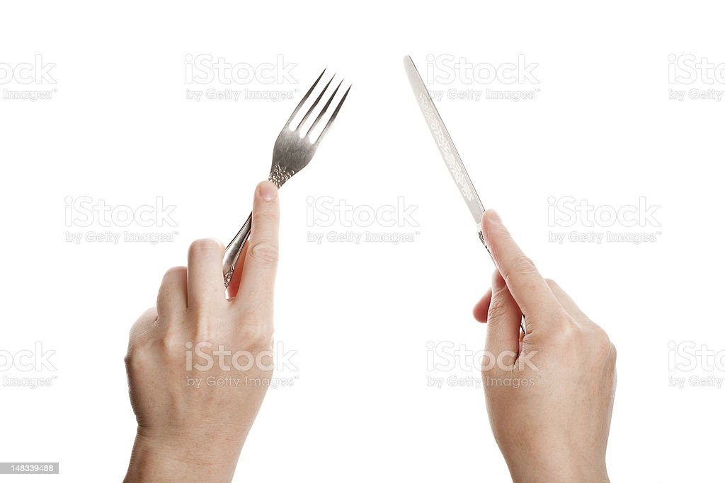 Knife and fork in hands stock photo