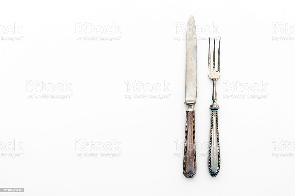 knife and fork isolated on white - beautiful silver cutlery stock photo