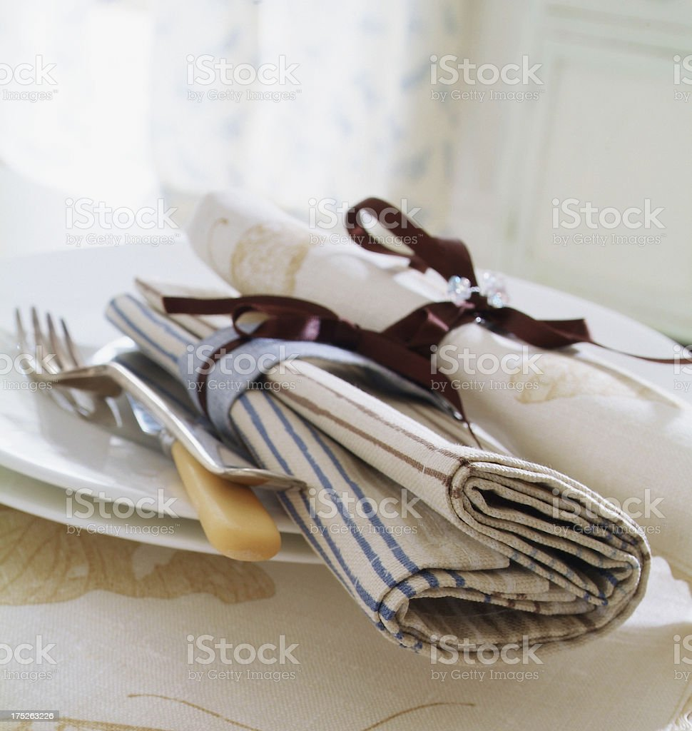 Knife and Fork on plate with napkin royalty-free stock photo