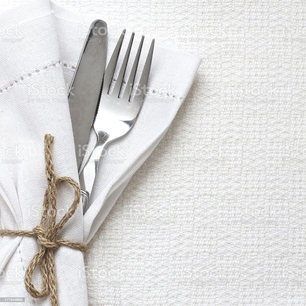 Knife and fork with white linen stock photo