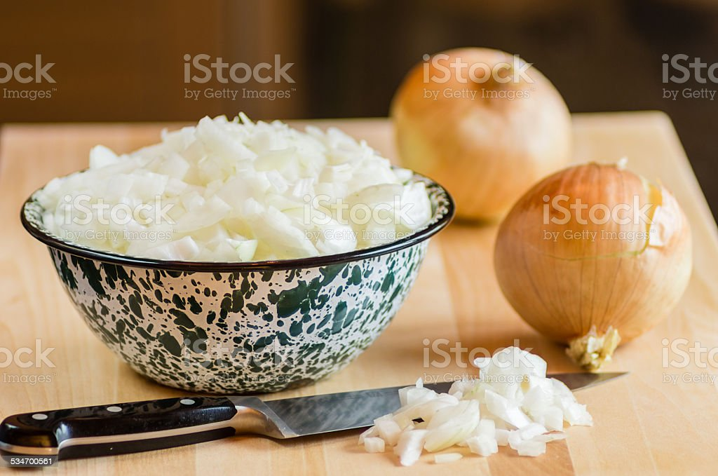 Knife and freshly chopped onions stock photo