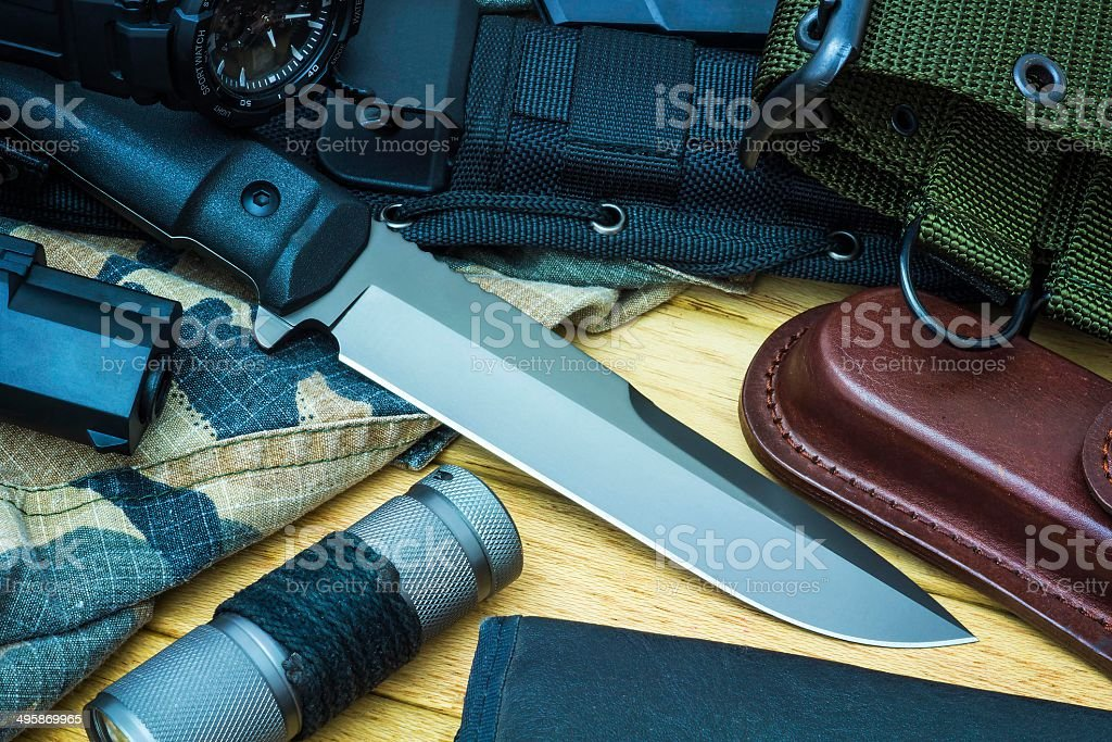 Knife and military equipment stock photo