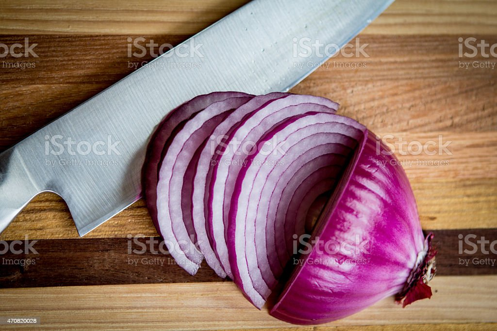 Knife and Onion stock photo