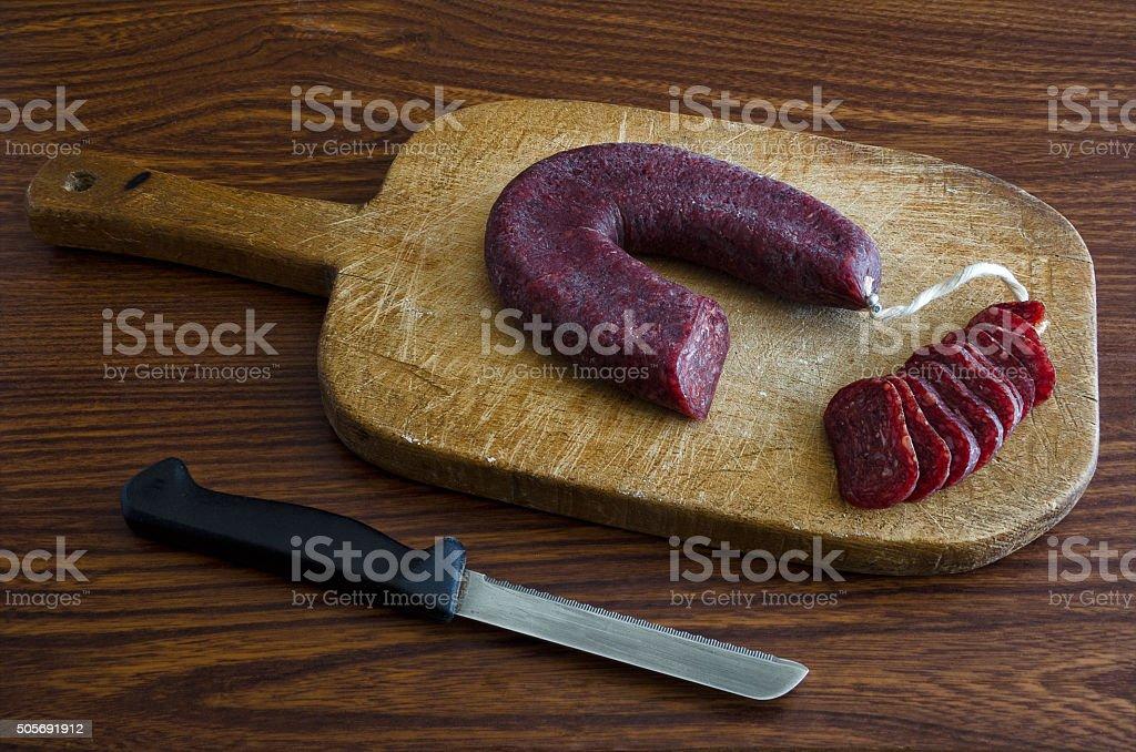 Knife and salami stock photo