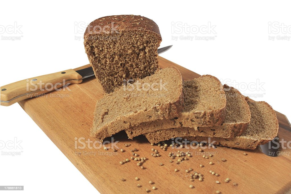 Knife, chopped rye bread on a cutting board wooden. royalty-free stock photo
