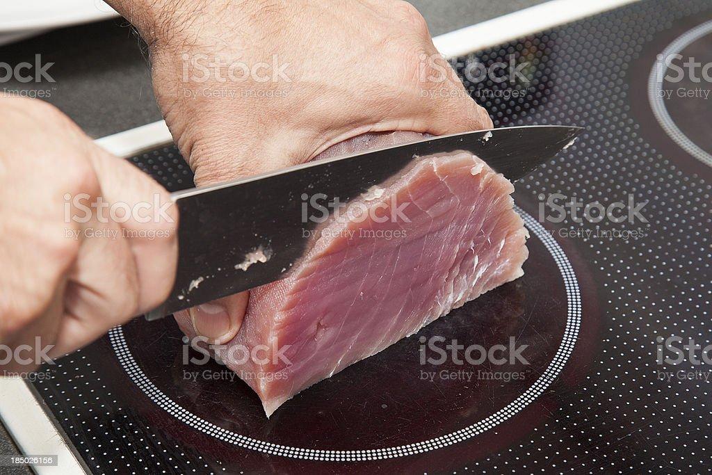 Knife Cutting Tuna Meat stock photo