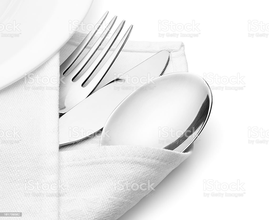 Knife, fork and spoon with linen serviette. stock photo