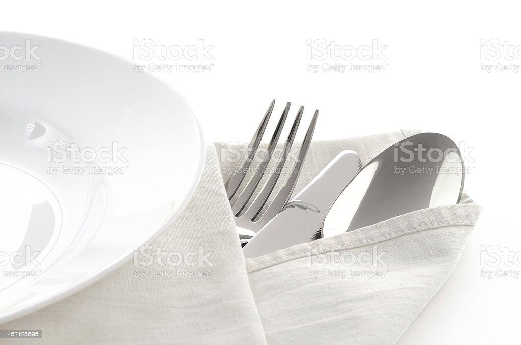 Cuchillo, cuchara y tenedor serviette con sábanas foto de stock libre de derechos