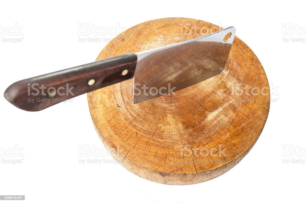 Knife on a wooden butcher on white background stock photo