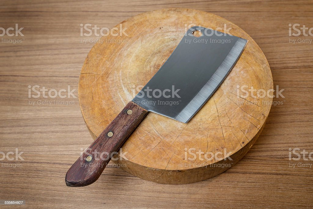 Knife on a wooden butcher on wooden background stock photo