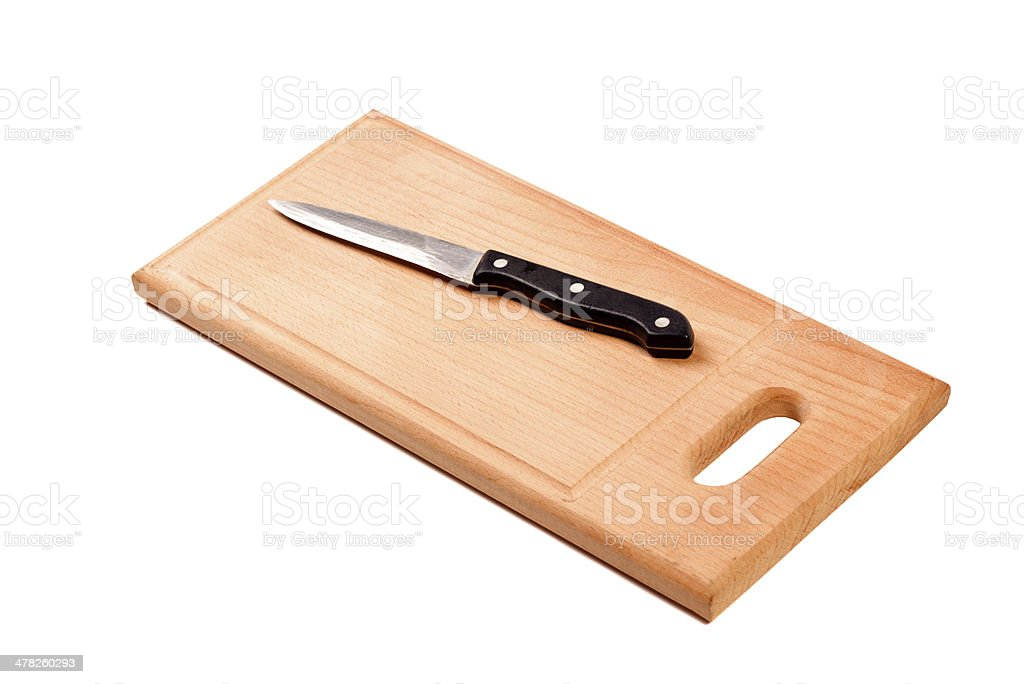Knife on cutting board isolated royalty-free stock photo
