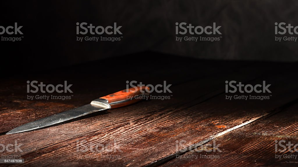 Knife on the table stock photo
