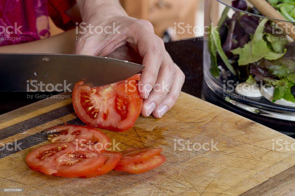 knife slicing tomato stock photo