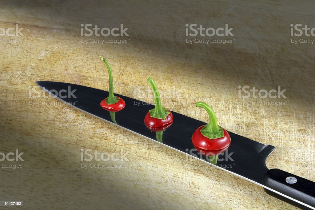Knife with Chopped Hot Peppers royalty-free stock photo